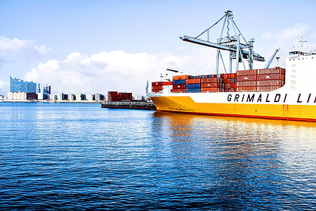yellow and white cargo ship on body of water during daytime