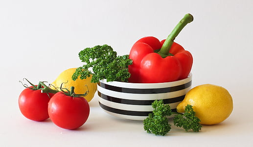 landscape photography of tomatoes, bell pepper, and limes