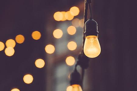 bokeh lights photograph of incandescent lamp