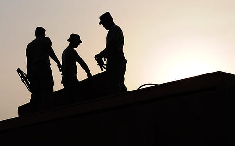 silhouette photo of three men