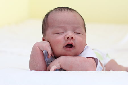 baby leaning on textile