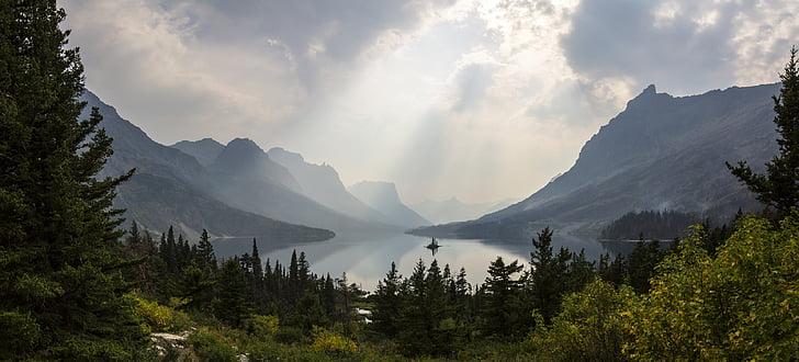 gray mountain beside body ofwater