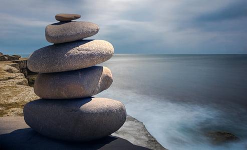 photo of five gray stones near cliff