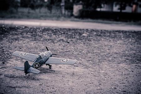 grey military biplane scale model