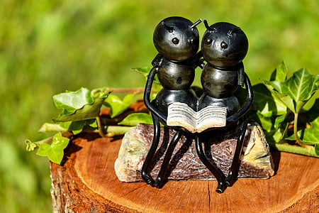 selective focus photography of ants figurine