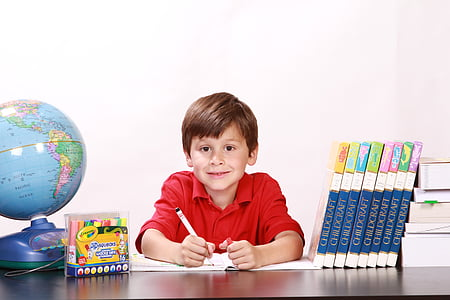 boy holding pen