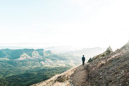 man standing beside mountain