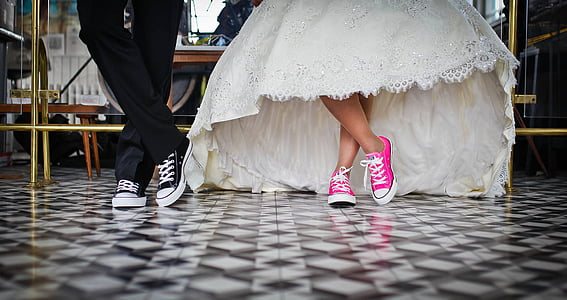 photo of two person wearing casual shoes