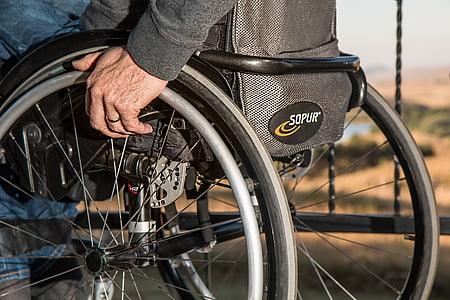 person on black wheelchair