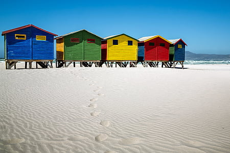 five assorted-color beachside cabins