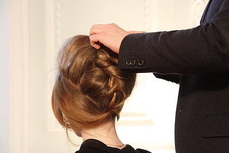 person brown braid hair