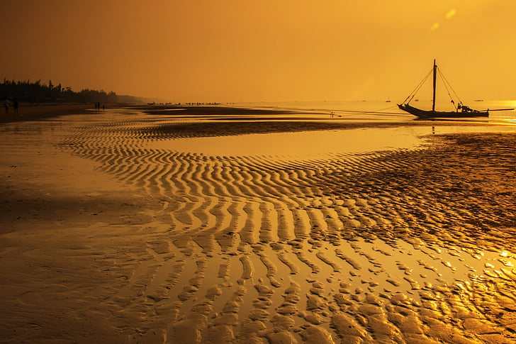 boat on sea near seashore during golden hour