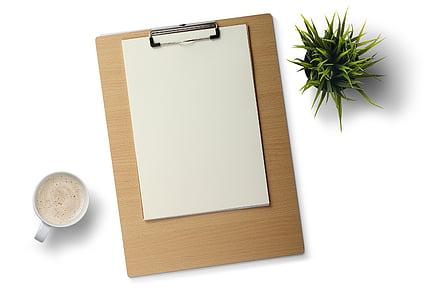 white printer paper on brown clip board