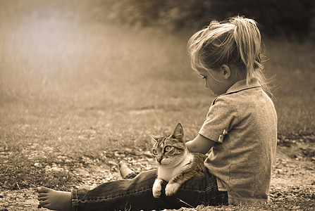 grayscale photo of girl and cat