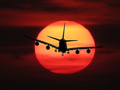 silhouette photo of air liner during golden hour