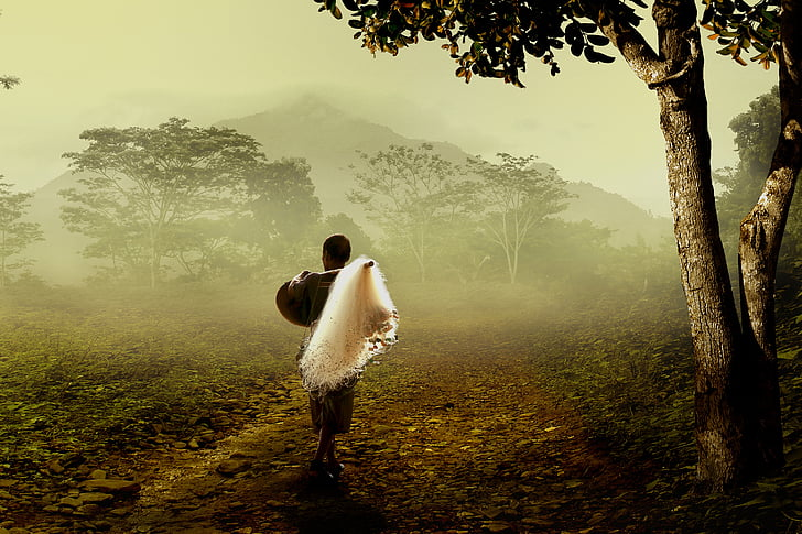 landscape photo of person carrying fishing net