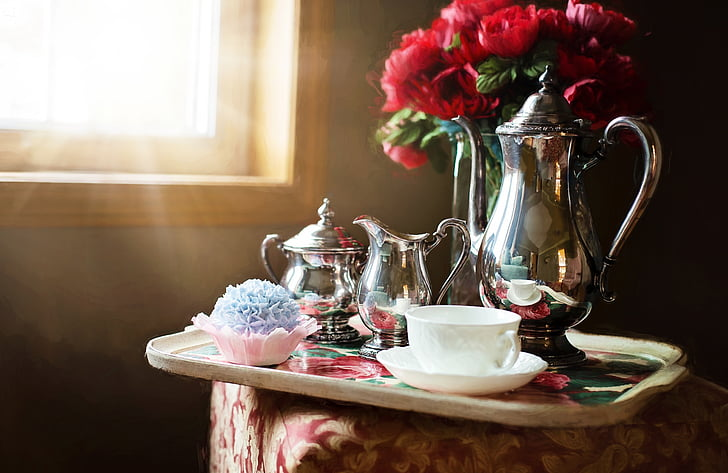 tray of silver and white teaset near window