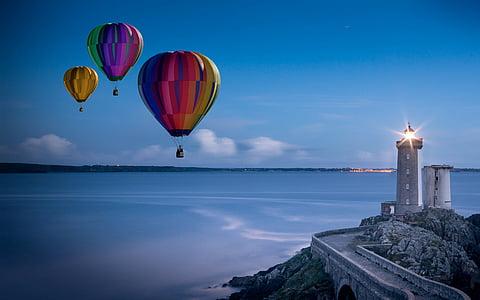 three pink hot air balloons