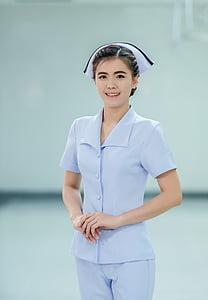 woman wearing nurse uniform