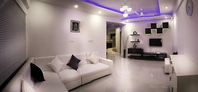 white sectional couch in front of white wooden sideboard