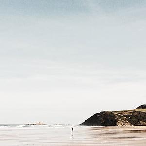 person near seashore during daytime