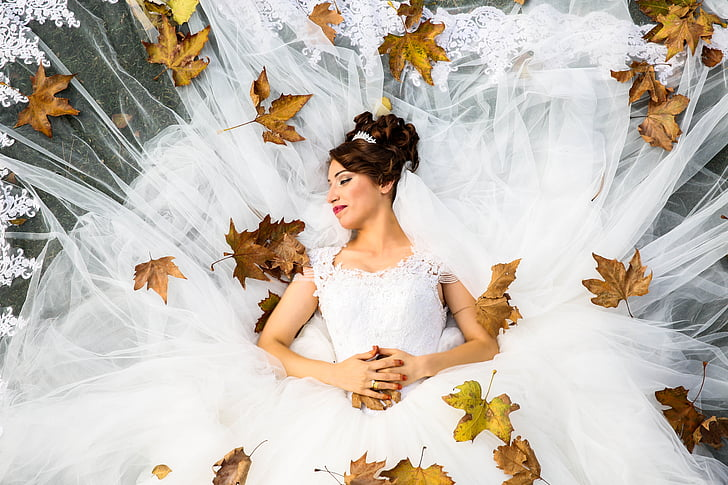 Royalty Free Photo Woman Wearing White Wedding Gown Posing For