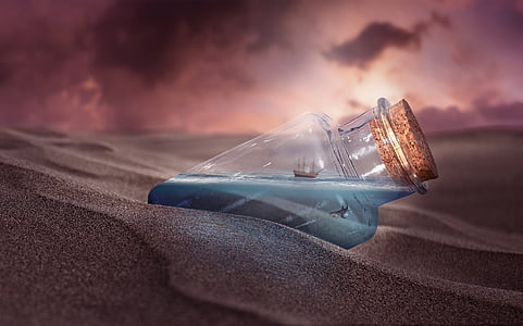 forced perspective photography of ship in a bottle