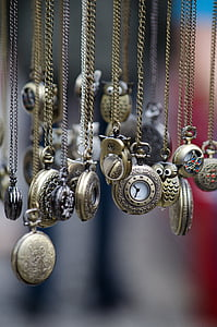 assorted pocket watches in shallow focus lens
