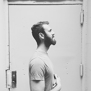 gray scale photo of man in shirt