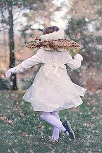 woman wearing white dress walking on green grass