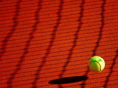 green tennis ball at daytime
