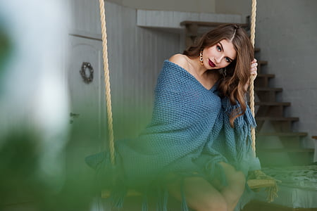 woman wearing blue towel sit on swing selected photography
