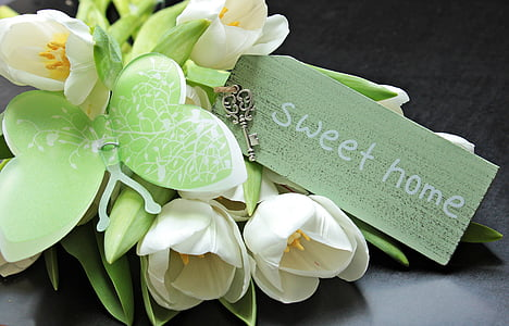 green and white flower arrangement with Sweet Home printed card