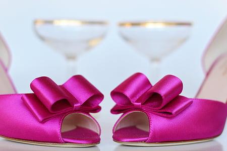 pair of pink pumps