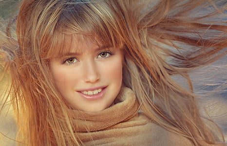 smiling woman hair blow with wind