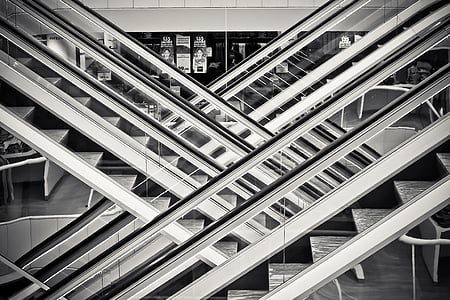 gray scale photo of escalators