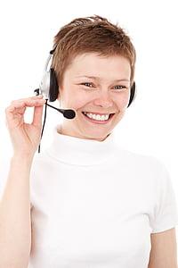 woman in white turtleneck shirt wearing headset