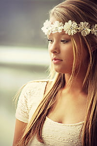 woman in white scoop-neck top wearing white floral hair accessory