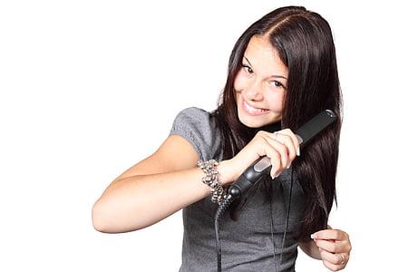 woman holding black hair straightener
