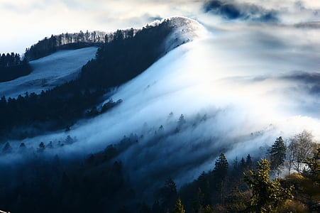 aerial photography of mountain covered with clouds during daytime