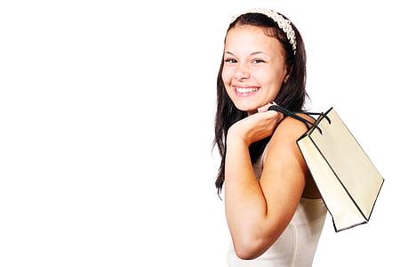 woman in white tank top holding white handbag