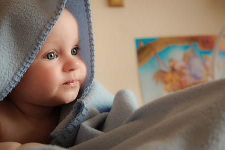 shallow focus photography of infant