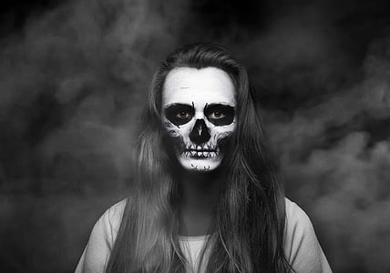 woman in black top with skull face paint