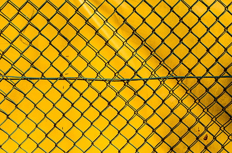 closeup photo of black wire metal fence