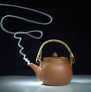 brown clay mold kettle with smoke