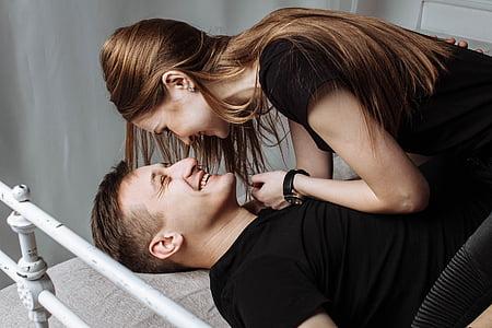 man wearing black shirt beside the woman