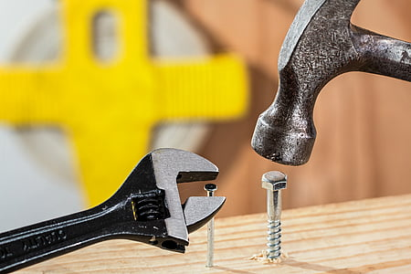 hammer and adjustable wrench