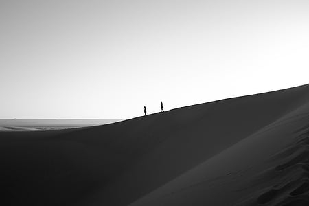 two person walking on desert silhouette