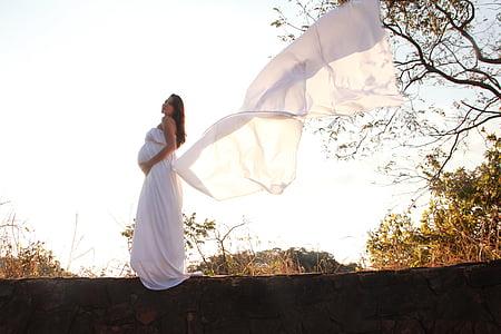 woman wearing white long dress