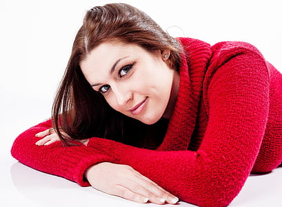 woman wearing red knitted sweater]